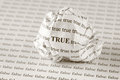 True or false crumpled paper ball with words on background with words sepia Royalty Free Stock Image