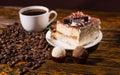 Truffles, Tiramisu and Black Coffee on Wood Table Royalty Free Stock Photo