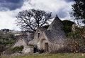 Trulli ouse a trullo plural is a traditional apulian dry stone hut with a conical roof their style of construction is specific to Royalty Free Stock Photos