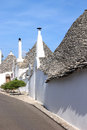 Trulli in street in alberobello italy is a small town and comune the italian province of bari puglia and is famous for its unique Stock Photography