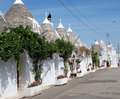 Trullo Street with Grape Vines Stock Photography