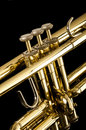 Trumpet on black brass a background Stock Image