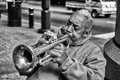 Trumpet player charlotte north carolina october an unidentified african american street performer playing blues style music on the Stock Photos