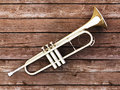 Trumpet on wood Stock Photography