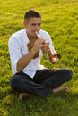 The trumpeter on a grass Royalty Free Stock Images