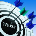 Trust on dartboard shows reliability and confidence Royalty Free Stock Photos