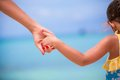 Trust family hands of child girl and mother on white tropical beach Royalty Free Stock Photography