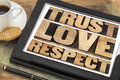 Trust love and respect words word abstract in vintage letterpress wood type on a digital tablet Royalty Free Stock Photo
