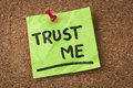 Trust me message or reminder handwriting on green sticky note Stock Image