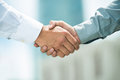 Trusted partnership close up image of a firm handshake standing for a Stock Photo