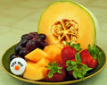 Try fresh fruit me button on the platter suggests a healthy snack Stock Image