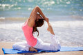 Trying some yoga poses at the beach Royalty Free Stock Photo