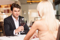 Trying to seduce attractive men with wine glass looking at beautiful woman Royalty Free Stock Photography