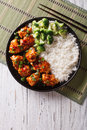 Tso's chicken with rice, onions and broccoli. vertical top view Royalty Free Stock Photo