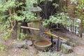 Tsukubai water fountain and stone lantern in japanese garden with basin bamboo spigot at portland Stock Image