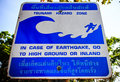 Tsunami evacuation sign near a beach in thailand Stock Photos