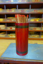 Tsz wan temple, with a hell representation, with sticks inside of a red wooden canister, in Hong Kong, China