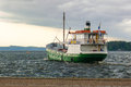 Ttretjak small cargo ship delivering goods and leaving from the harbor Royalty Free Stock Image