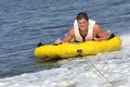 Tuber Sliding Outside of Boat Wake Royalty Free Stock Images