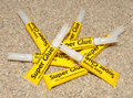 Tubes of super glue yellow adhesive on a gravel texture background Royalty Free Stock Image