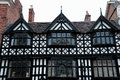 Tudor buildings building showing intricate patterns on the facade and lovely leaded windows Stock Photos