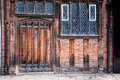 Tudor door and windows an old leaded in stratford upon avon england uk view also show wooden beams along the brick work Stock Images
