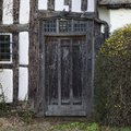 Tudor doorway front entrance to an old cottage warwickshire england Royalty Free Stock Photography