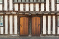 Tudor house doors to the timber framed in style stratford england Royalty Free Stock Photos