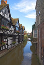 Tudor houses and river these old lie on a which is used to take people around the city town of canterbury Royalty Free Stock Image