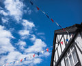 Tudor summer bunting traditional building in england with hanging Royalty Free Stock Photos