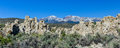 Tufa formation in mono lake california state natural reserve with snow covered sierra mountains the background Royalty Free Stock Photo