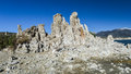 Tufa formation in mono lake california state natural reserve with snow covered sierra mountains the background Stock Image
