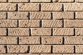 Tuff bricks wall made with rock regular Stock Photo
