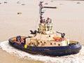 Tug boat navigating the estuary of the river thames near tilbury essex england Stock Image