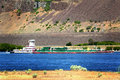 Tug boat pushing barge a a in the traffic lane in the columbia river gorge common daily scene Royalty Free Stock Image