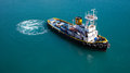 Tug boat ready to serve a cruise ship Stock Photo