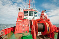 Tug boat red tugboat on a baltic sea in gdansk poland Royalty Free Stock Image