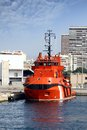 Tug docked rescue in the port of alicante Stock Photos