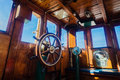 Tug vessel deck command wheel harbor vessels small wooden room with wooden steering and signal gauges to engine room from pilot Stock Photo