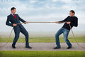 Tug of war between the same man work life balance conflict concept Royalty Free Stock Photo