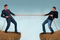 Tug of war test of strength man pulling rope over a crevasse Royalty Free Stock Photos