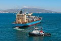 Tugboat and container ship at algeciras bay Stock Photos