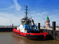 Tugboat moored at bremerhaven red next to the historic lighthouse harbor Royalty Free Stock Image
