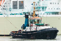 Tugboat pulling large sea ship dutch rotterdam harbor Royalty Free Stock Images