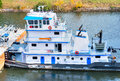 Tugboat pushing a barge in tennessee tombigbee waterway Stock Images