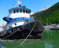 A tugboat tied to a wharf at skagway Royalty Free Stock Photo