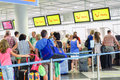 Tuifly passengers tui fly at the munich airport check in counter focus is on the screen most to the right Royalty Free Stock Photos