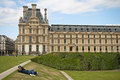 Tuileries garden tourists relaxing on green grass Royalty Free Stock Images
