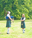 Tuition: playing the Bagpipes. Royalty Free Stock Image