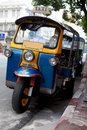 Tuk Tuk by the road side in Bangkok Thailand Stock Photos